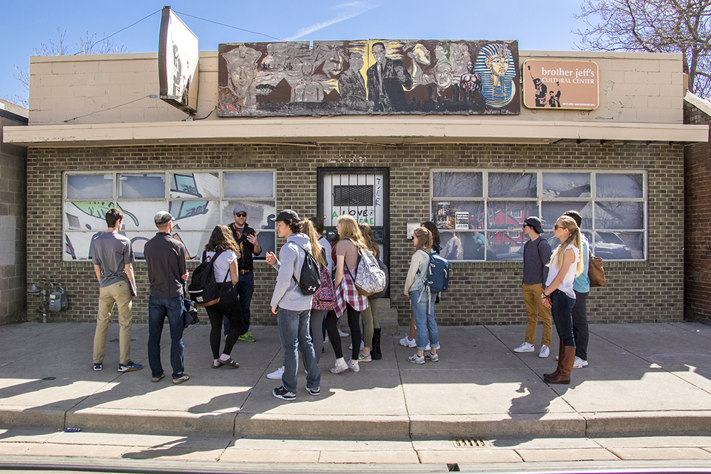 Steve Luebke leads a History Colorado tour of Welton Street for a class from the Alexander Dawson School, March 15, 2018. Here they've arrived in front of Brother Jeff's Cultural Center. (Kevin J. Beaty/Denverite)  denver; denverite; kevinjbeaty; colorado; five points; welton street;