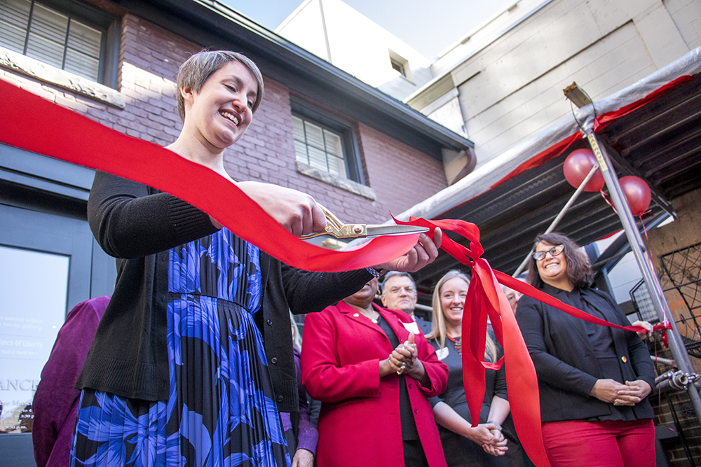 The Center for Colorado Women's History director, Jillian Allison, cuts a ribbon as the center opens at the Byers-Evans House, March 21, 2018. (Kevin J. Beaty/Denverite)  history; museum; denver; colorado; denverite; kevinjbeaty;