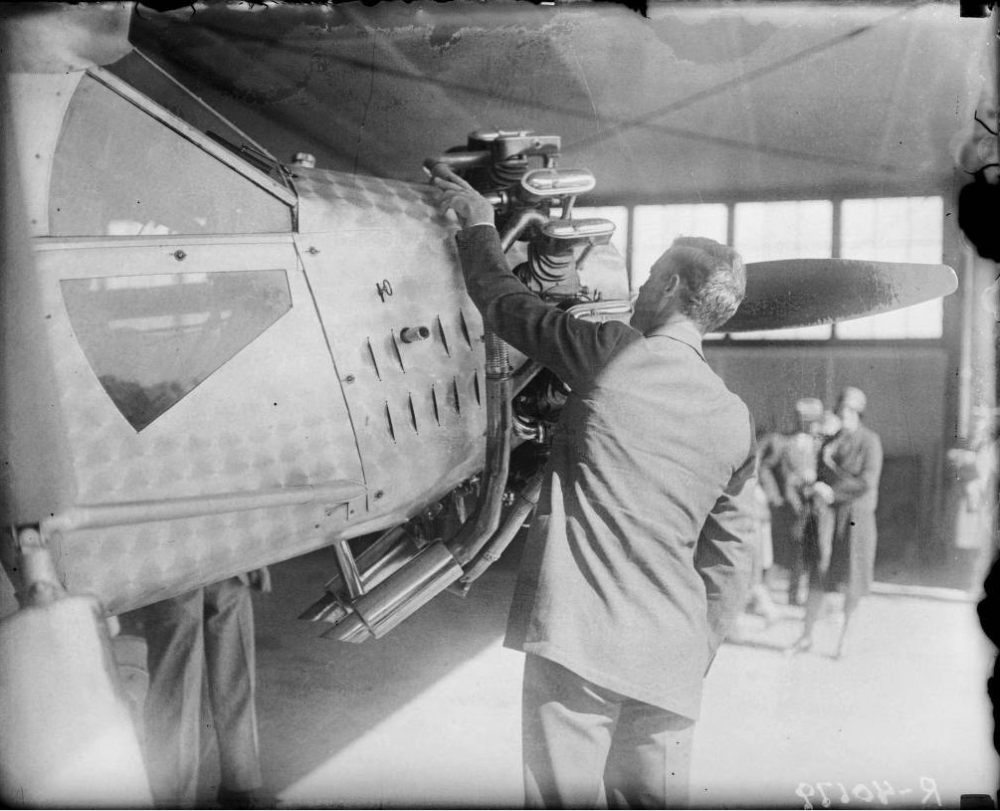 Charles Lindbergh examines an airplane in 1927, likely at Lowry Field in Denver. (Harry Mellon Rhoads/Denver Public Library/Western History & Genealogy Dept./RH-115)