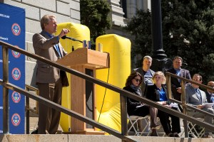 DaVita CEO Kent Thiry speaks at a press conference for the new UChooseCO campaign, which aims to inform unaffiliated voters that they can now participate in primary elections. April 3, 2018. (Kevin J. Beaty/Denverite)