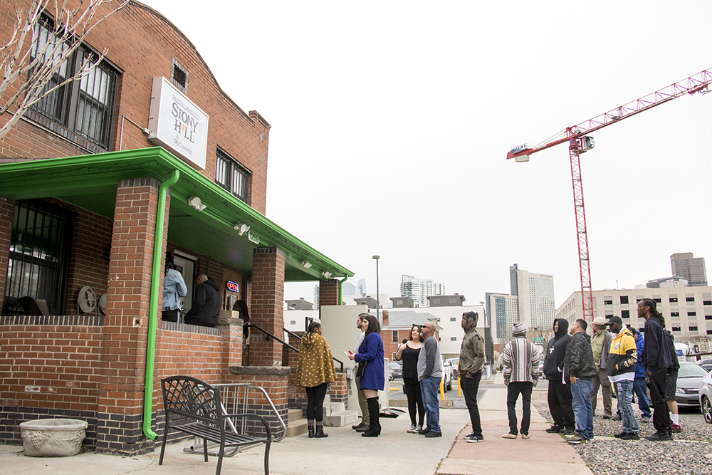 It's 11 a.m. and there's a huge line outside of the Stony Hill dispensary before Denver's 2018 Mile High 420 Festival, April 20, 2018. (Kevin J. Beaty/Denverite)