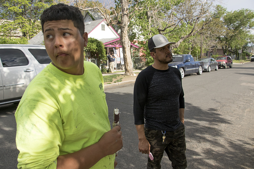 Manny Herrera (right) and his brother, Anthony, eat ice cream in front of their mother's house in Elyria-Swansea, May 15, 2018. (Kevin J. Beaty/Denverite)  denver; colorado; denverite; kevinjbeaty; elyria swansea; development; gentrification;