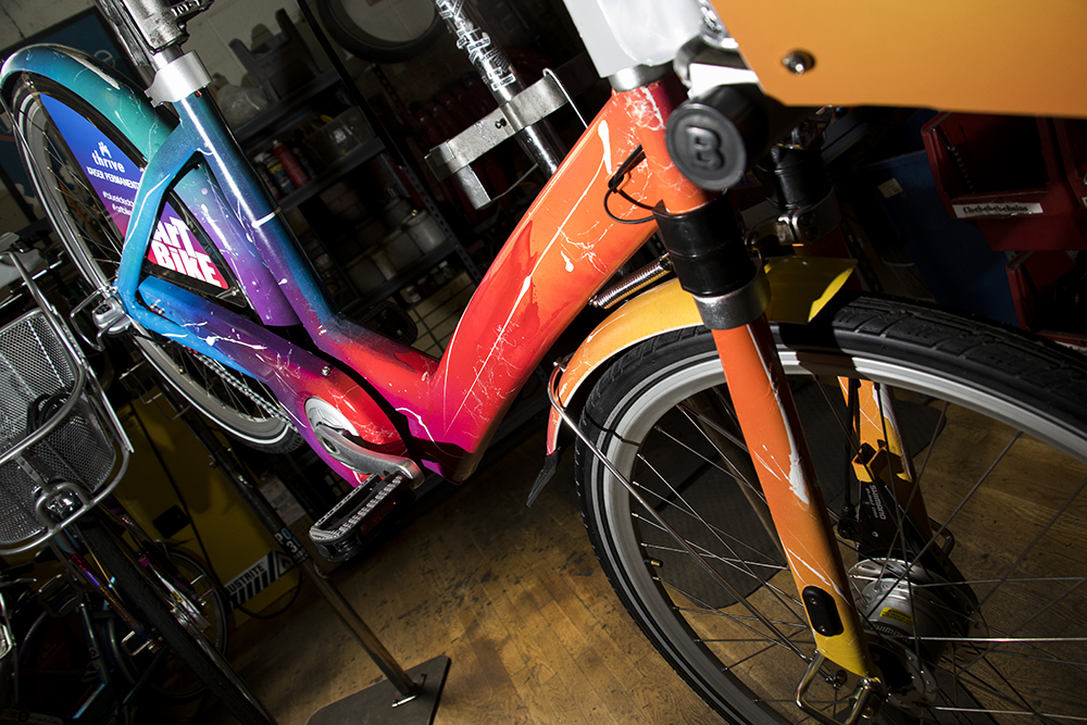 The custom B-Cycle by Thomas Evans, known as Detour. Denver B-Cycle and Kaiser Permanente unveil four hand-painted bikes at their headquarters on Larimer Street, May 31, 2018. (Kevin J. Beaty/Denverite)  denver; colorado; denverite; b-cycle; bikes; bicycles; rino; five points; transportation; art; public art; kevinjbeaty;