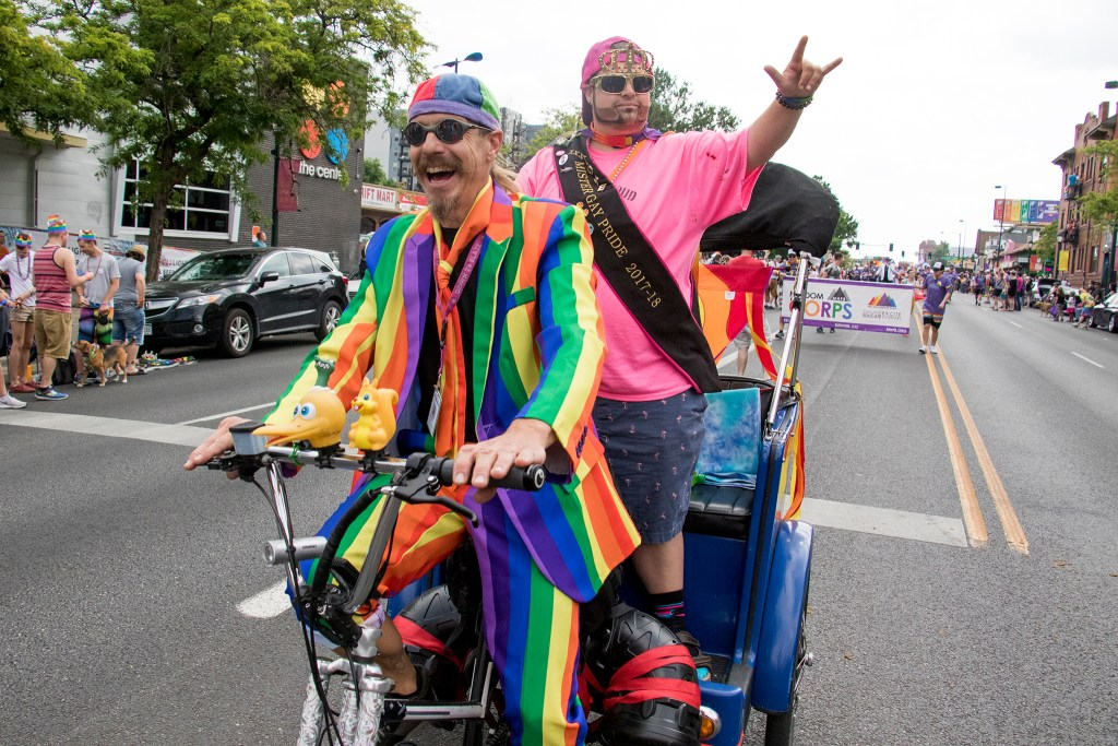 Ron Rickshaw and Gay Onyx Steele ride a pedicab down Colfax during the Denver PrideFest parade, June 17, 2018. (Kevin J. Beaty/Denverite)