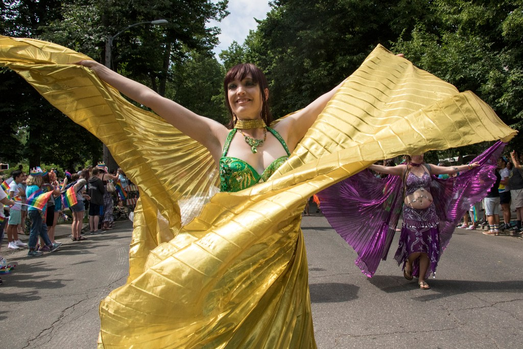 Micaela Cruce dances in a flowing dress in the Denver PrideFest parade, June 17, 2018. (Kevin J. Beaty/Denverite)