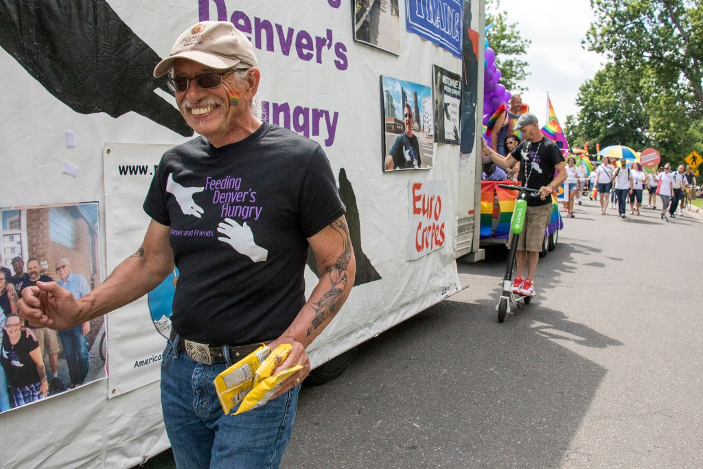 Mile High Comics owner Chuck Rozanski  marches in the Denver PrideFest parade, June 17, 2018. (Kevin J. Beaty/Denverite)