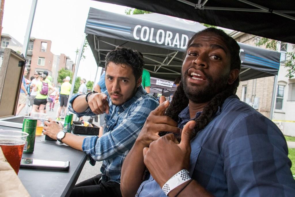 Denverite reporters Esteban L. Hernandez (left) and Allan Tellis man the Denverite booth at the Denverite Detour on Bike To Work Day, June 27, 2018. (Kevin J. Beaty/Denverite)