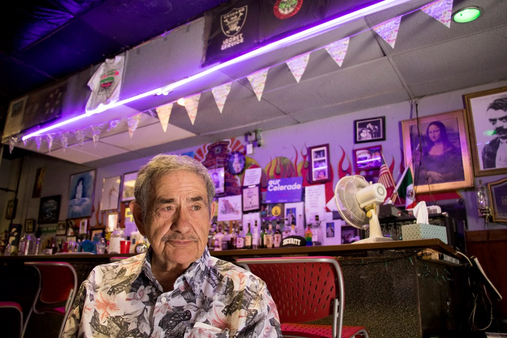 Tim Correa, owner of the Aztlan Theatre, speaks to a reporter in the bar adjacent to his performance space, July 19, 2018. (Kevin J. Beaty/Denverite)