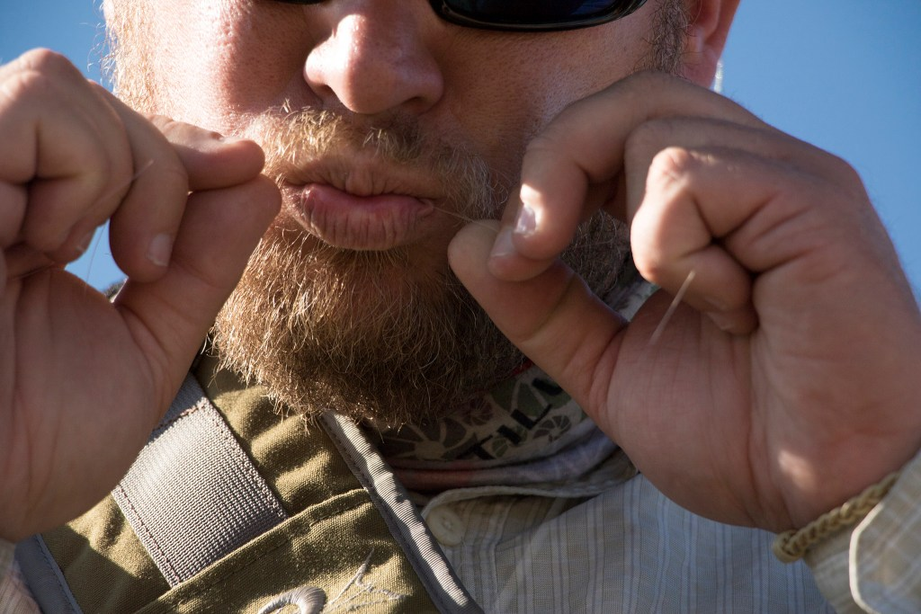 Ty Clifton ties a fly lure onto his line. Denver Trout Unlimited's 12th annual Carpslam flyfishing tournament on the South Platte River, Sept. 9, 2018. (Kevin J. Beaty/Denverite)