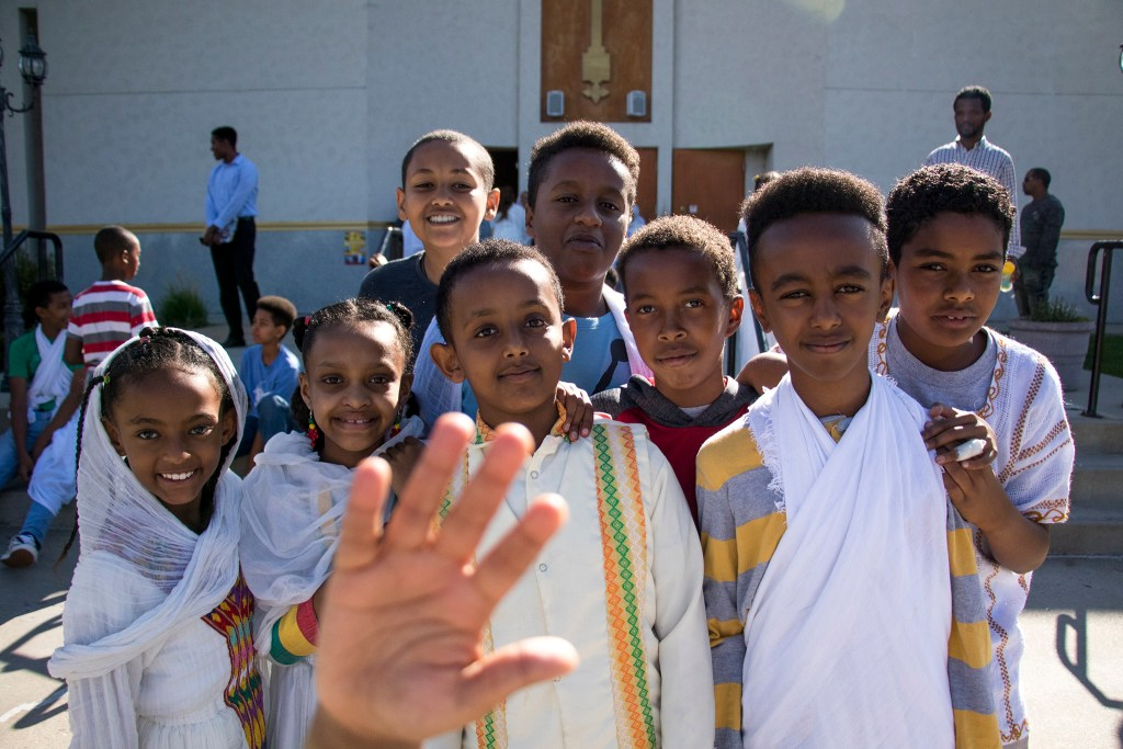Kids clamor for a portrait during Ethiopian New Year at St. Mary Ethiopan Orthodox Church in Aurora, Sept. 9, 2018. (Kevin J. Beaty/Denverite)