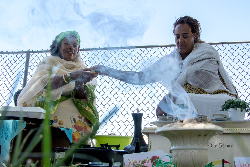 Ethiopia Asfwe performs an Ethiopian coffee ceremony after New Year services at St. Mary Ethiopan Orthodox Church in Aurora, Sept. 9, 2018. (Kevin J. Beaty/Denverite)