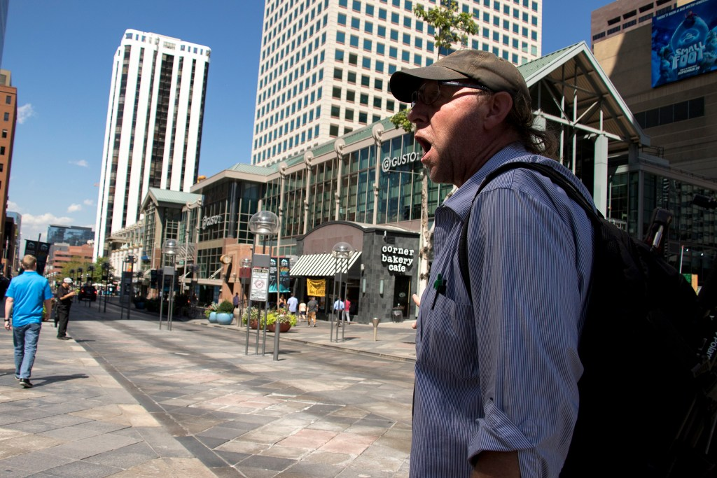 Benjamin Dunning, co-founder of Denver Homeless Out Loud, leads a tour showing how Business Improvement District policies have pushed people experiencing homelessness out of public spaces, Sept. 18, 2018. (Kevin J. Beaty/Denverite)