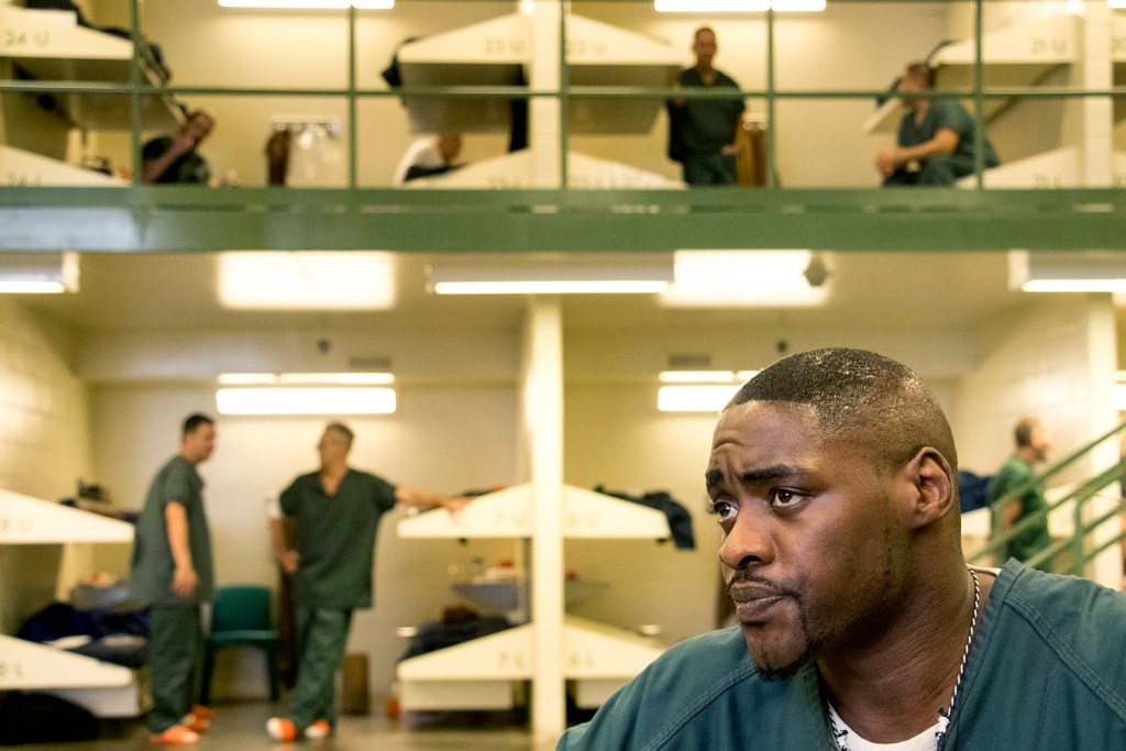 Antoine Calvin-Spencer speaks to a reporter as the Colorado Criminal Justice Reform Coalition visits the Denver's downtown detention center to promote voter registration. Oct. 11, 2018. (Kevin J. Beaty/Denverite)