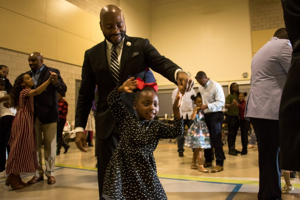 Michael Dennis and his daughter, Kaitlyn (5), dance during A Father Daughter Occasion at the Dahlia Campus for Health and Well-Being in Northeast Park Hill, Oct. 27, 2018. (Kevin J. Beaty/Denverite)