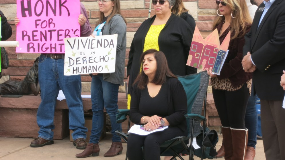 Claudia Vazquez, seated, and other members of the grassroots group UNE at a news conference Oct. 1, 2018 celebrating the creation of a legal aid clinic for renters for which they lobbied. (Donna Bryson/Denverite)