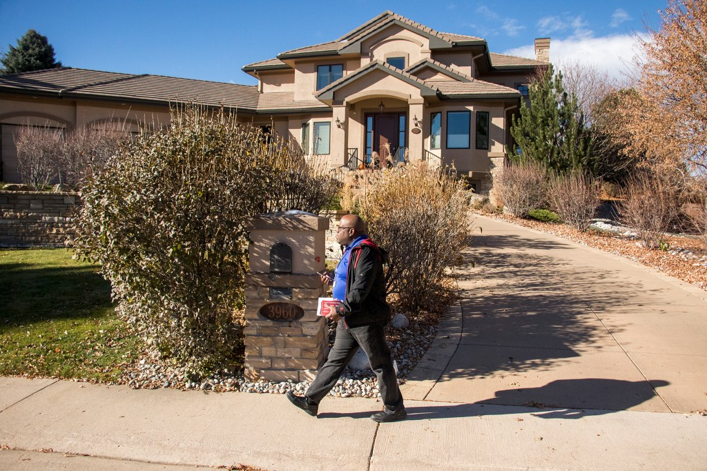 Kevin Young canvasses for the GOP in a Littleton neighborhood, Nov. 2, 2018. (Kevin J. Beaty/Denverite)