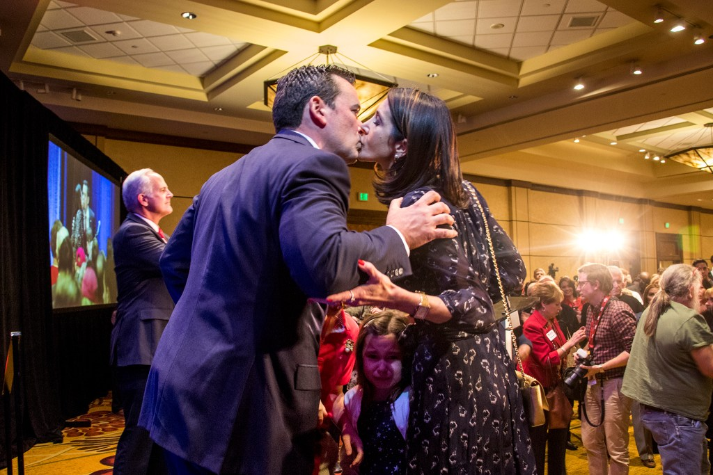 Walker Stapleton kisses his wife, Jenna, after his concession speech at the Colorado Republicans' election day party, Nov. 6, 2018. (Kevin J. Beaty/Denverite)