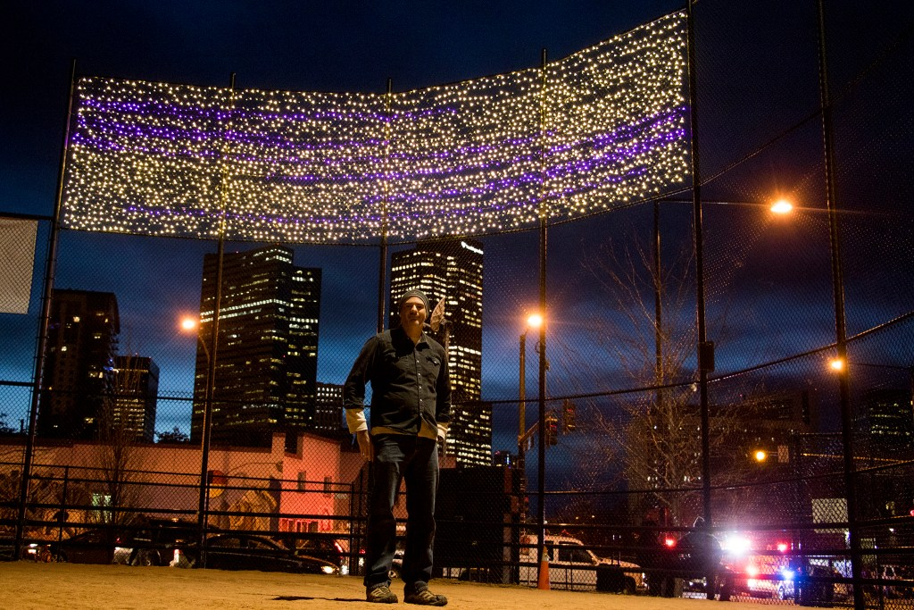 Chris Conner, director of Denver's Road Home, poses in front of lights the organization hung over Sonny Lawson Park, Five Points, Nov. 28, 2018. (Kevin J. Beaty/Denverite)