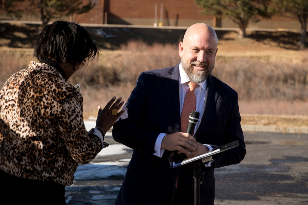 Project manager Leanne Wheeler welcomes Scott Bloyer, pastor of Elevation Christian Church, to speak. The Second Chance Center breaks ground on a new supportive housing project behind the Elevation Christian Church in Aurora, Jan. 4, 2018. (Kevin J. Beaty/Denverite)