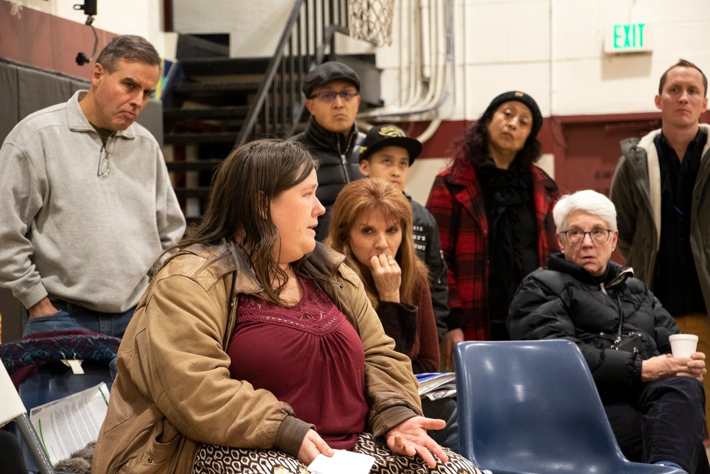 Sandra Hermans addresses the crowd as Globeville residents meet with representatives from the city and the Beloved Community tiny home village, Feb. 7, 2019. (Kevin J. Beaty/Denverite)