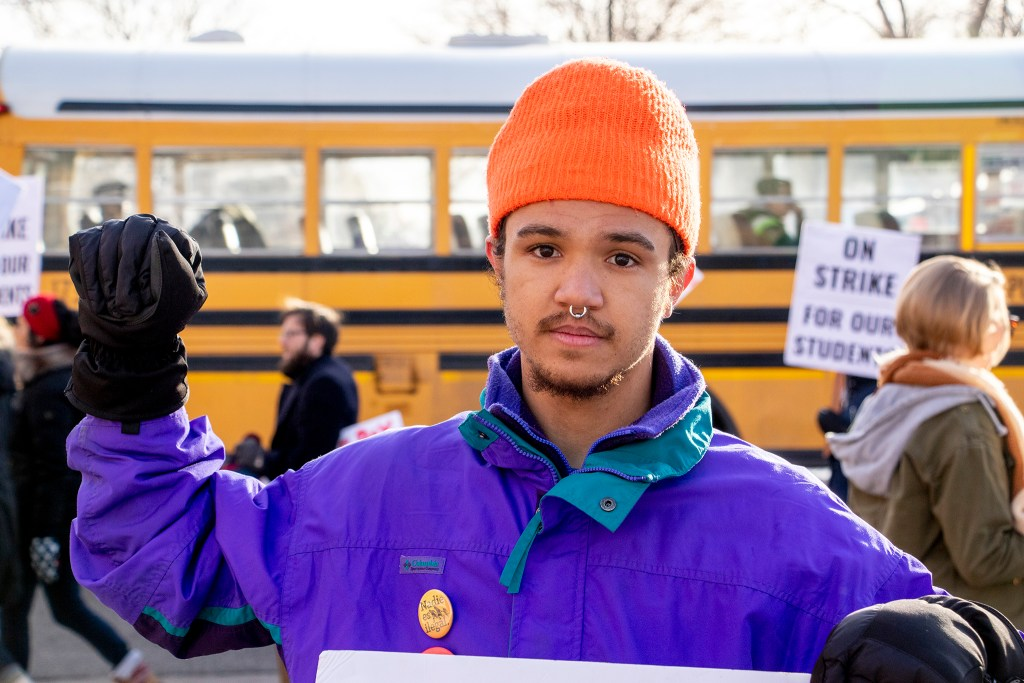 Manasseh Oso, who teaches 9th and 10th grade social studies at Manual High School, poses for a portrait on the picket line. Whittier, Feb. 13, 2019. (Kevin J. Beaty/Denverite)
