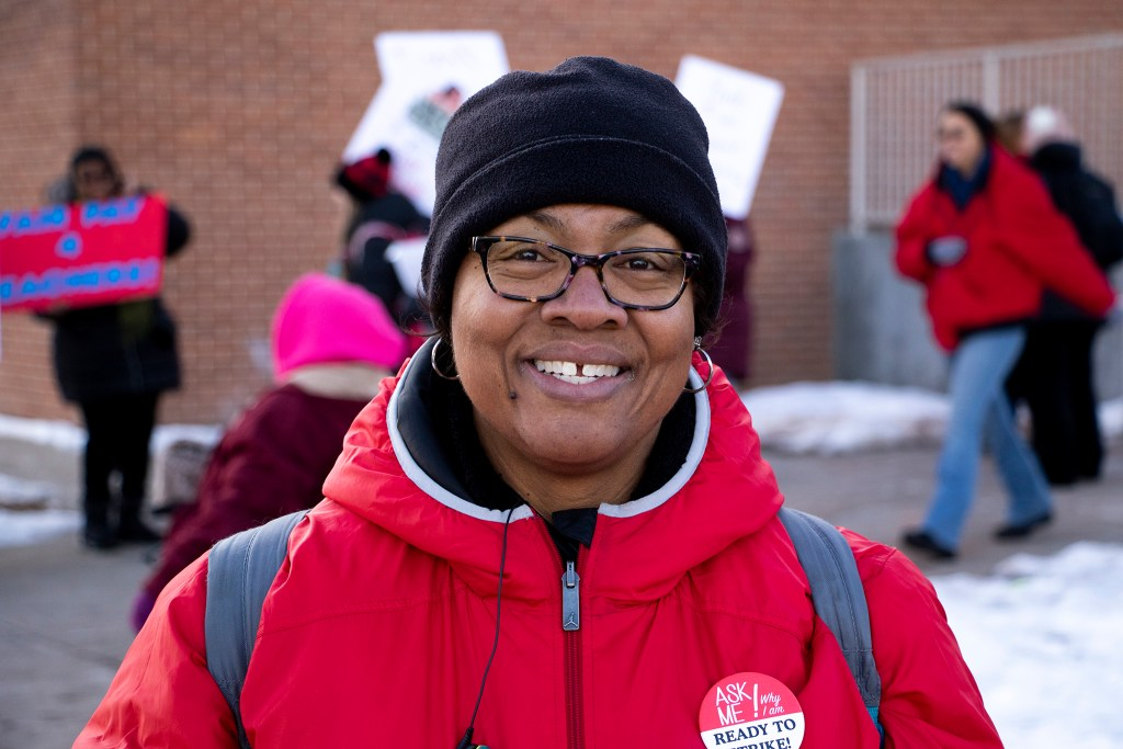 Lynette Hall-Jones, a teacher evaluator and former instructor at Whittier EOE - 8 School poses for a portrait in front of a picket line, Feb. 13, 2019. (Kevin J. Beaty/Denverite)