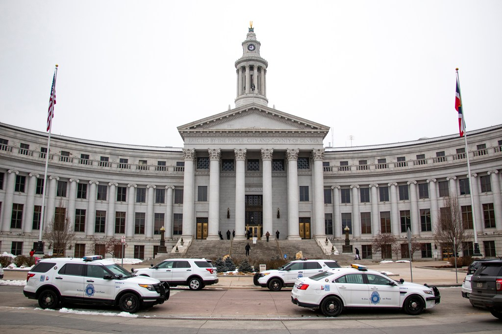 Police parked outside Denver's City and County Building during a lockdown Wed., Feb. 27, 2019. (Kevin J. Beaty/Denverite)