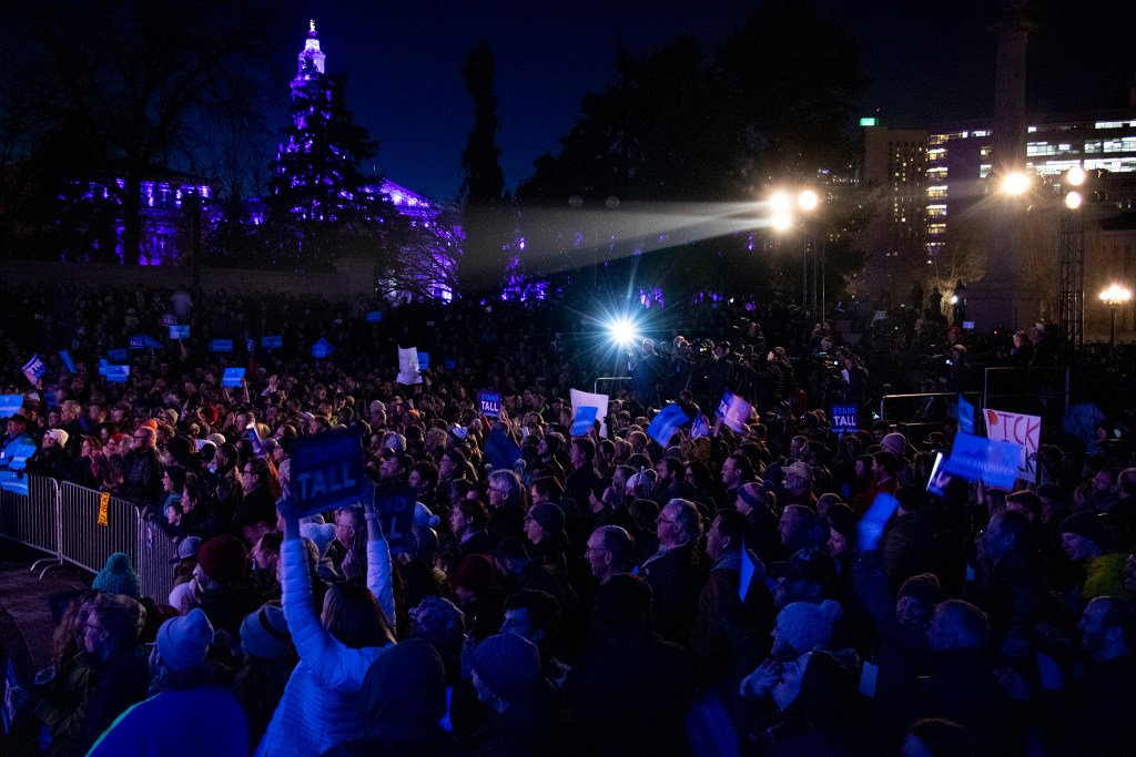 The crowd cheers as former Governor John Hickenlooper holds a rally at Civic Center Park for his run at the presidency, March 7, 2019. (Kevin J. Beaty/Denverite)