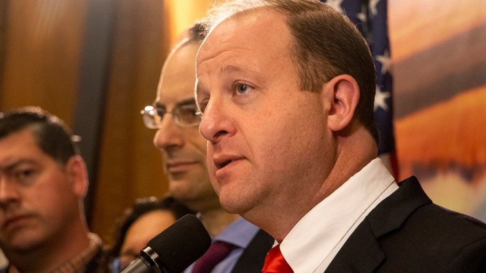 Gov. Jared Polis announces a lawsuit against the federal Justice Department for withholding grant money bound for state police departments, March 12, 2019. (Kevin J. Beaty/Denverite)