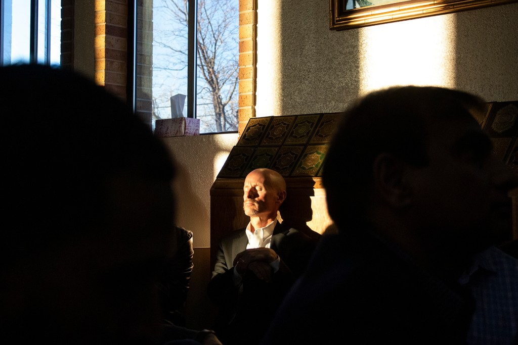 Former U.S. District Attorney Bob Troyer listens with closed eyes during a vigil for the victims of a massacre at a Christchurch, New Zealand, mosque at the Colorado Muslim Society, March 16, 2019. (Kevin J. Beaty/Denverite)