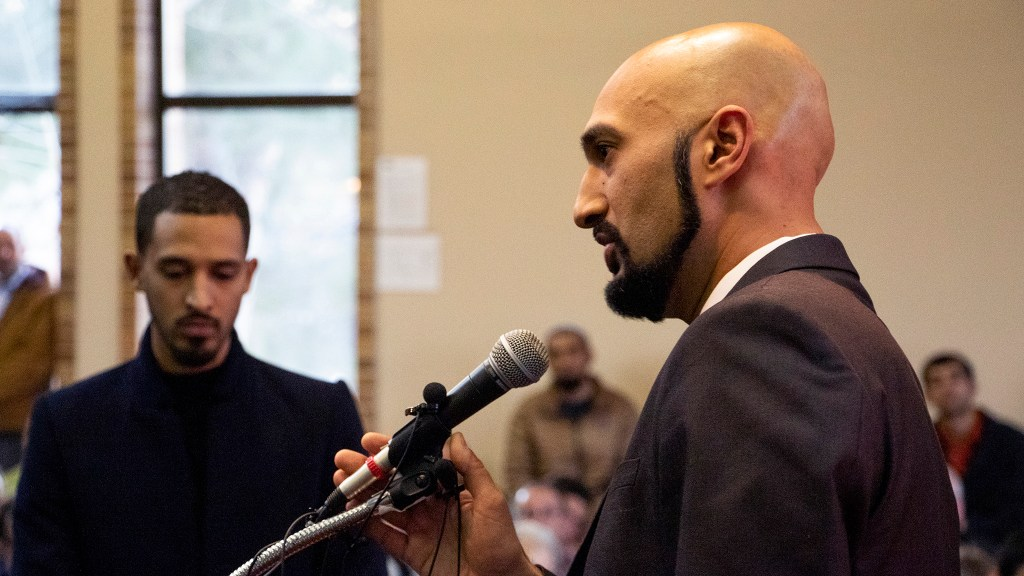 Qusair Mohamedbhai speaks during a vigil for the victims of a massacre at a Christchurch, New Zealand, mosque at the Colorado Muslim Society, March 16, 2019. (Kevin J. Beaty/Denverite)