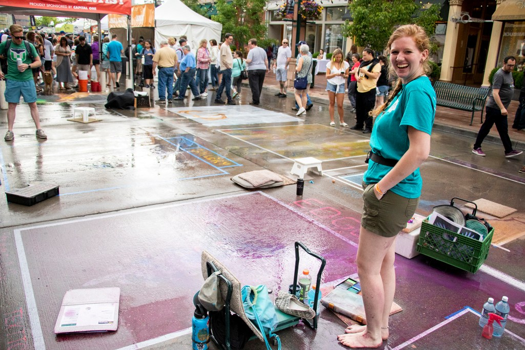 Samantha Nies poses for a portrait after it rained over the Denver Chalk Art Festival at Larimer Square, June 1, 2019. (Kevin J. Beaty/Denverite)