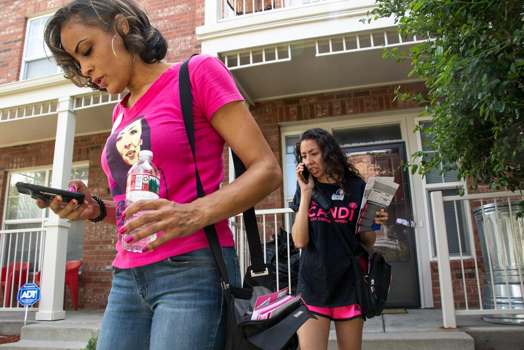 Candi CdeBaca (right) and Elisabeth Epps canvass in Five Points on election day, June 4, 2019. (Kevin J. Beaty/Denverite)