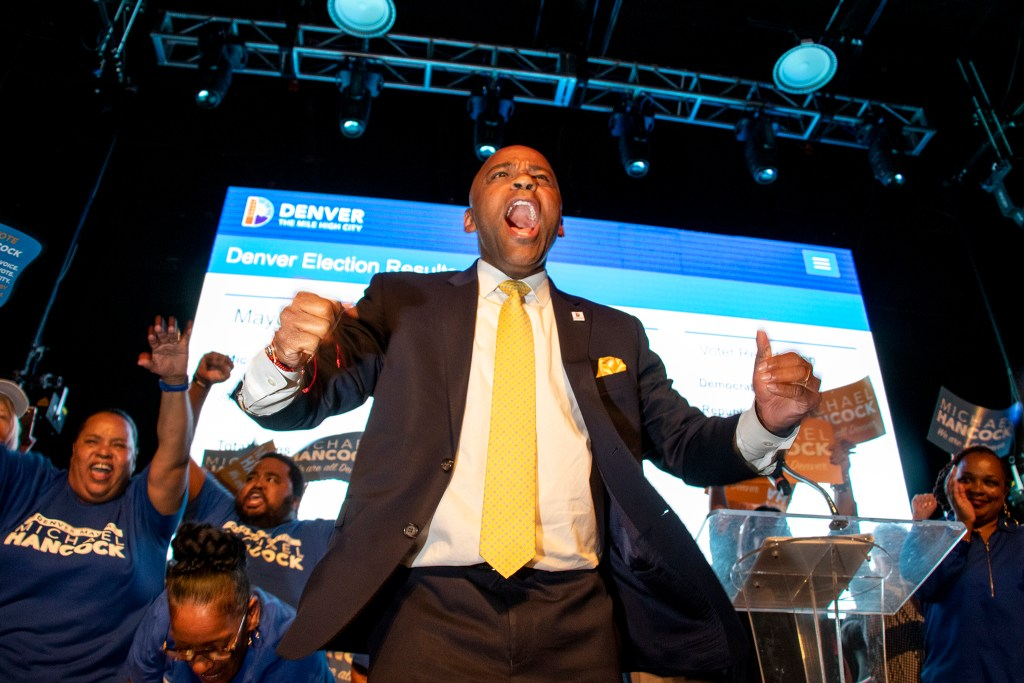 Mayor Michael Hancock walks on stage as he claims victory in the Denver mayoral race and celebrates at his election night party. (Kevin J. Beaty/Denverite)