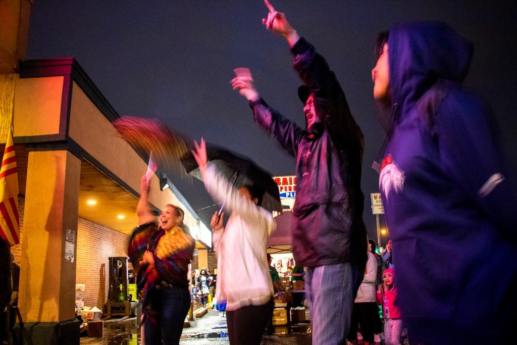 The aucience dances to Los Mocochetes in the rain. Little Saigon Night Market. Federal Boulevard, June 21, 2019. (Kevin J. Beaty/Denverite)