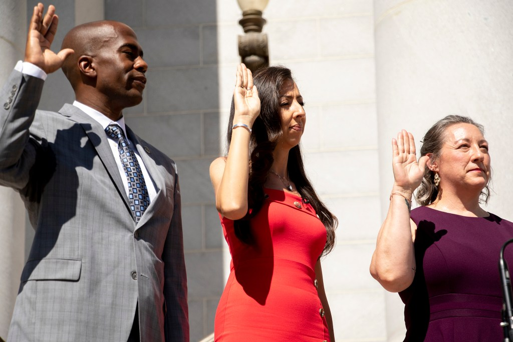 Chris Herndon, Cand CdeBaca and Stacie Gilmore are sworn in as City Councelors on the City and County Building steps, July 15, 2019. (Kevin J. Beaty/Denverite)