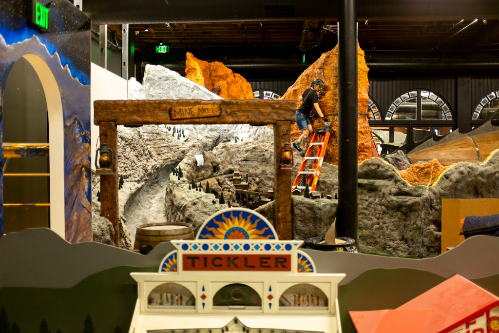 Amusement park- and mining town-themed holes under construction in Urban Putt's new location at the old Old Spaghetti Factory building downtown, July 16, 2019. (Kevin J. Beaty/Denverite)