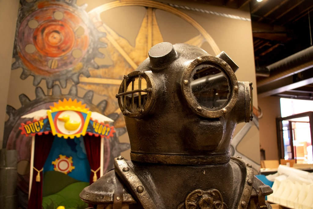 A diving bell and a carnival-themed hole inside Urban Putt's new location at the old Old Spaghetti Factory building downtown, July 16, 2019. (Kevin J. Beaty/Denverite)