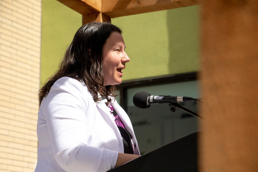 Britta Fisher, chief housing officer at Denver's Office of Economic Development speaks during a ribbon-cutting ceremony for the Arroyo Village apartments in Denver's West Colfax neighborhood, July 18, 2019. (Kevin J. Beaty/Denverite)