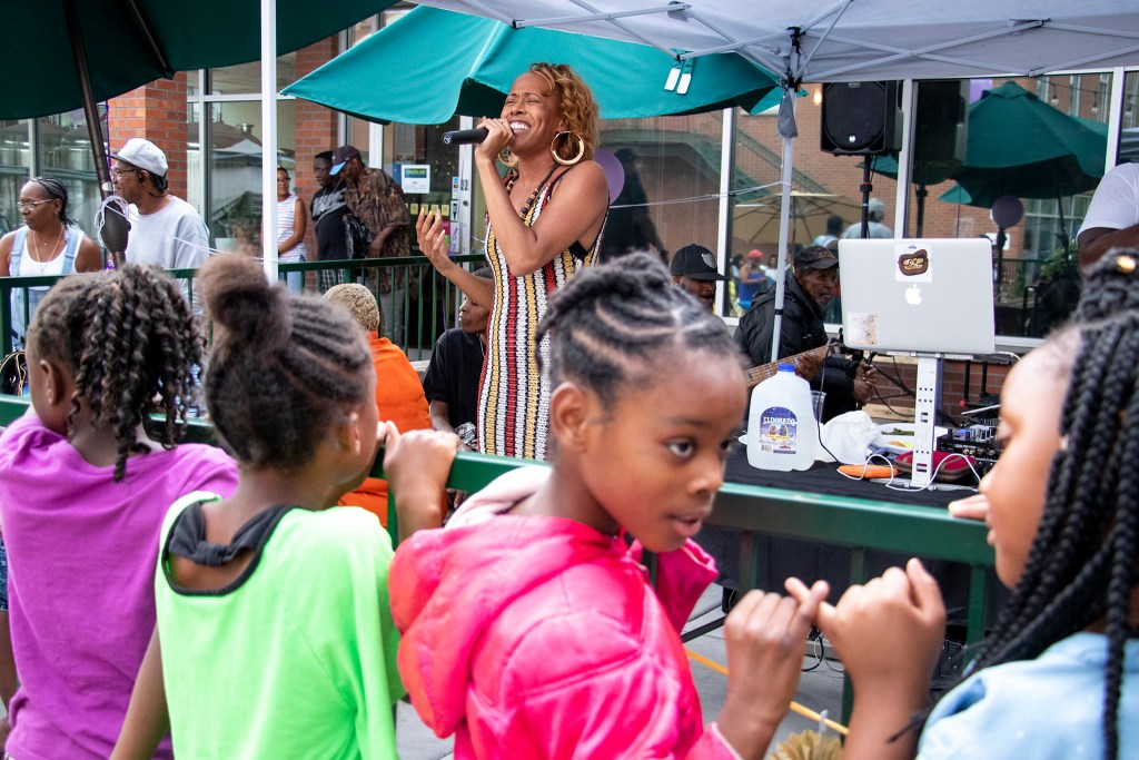 Young girls watch gobsmacked as Danette Hollowell Welton Street Cafe celebrates 20 years in one location. Five Points, July 30, 2019. (Kevin J. Beaty/Denverite)