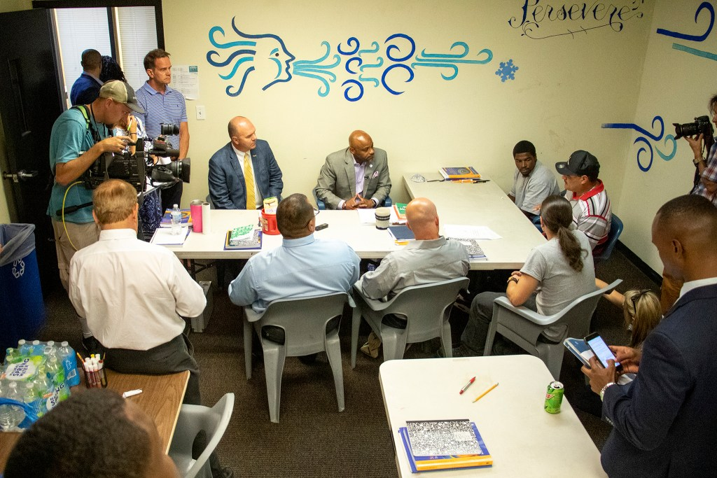 Mayor Michael Hancock meets with inmates living in CoreCivic's 90-day addiction treatment halfway house facility. Aug. 20, 2019. (Kevin J. Beaty/Denverite)