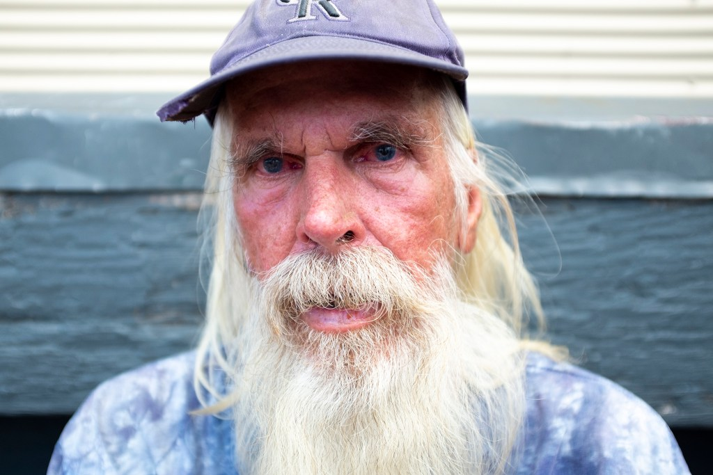 James Aidken poses for a portrait outside of the Salvation Army's Crossroads shelter for the unhoused, Aug. 23, 2019. (Kevin J. Beaty/Denverite)