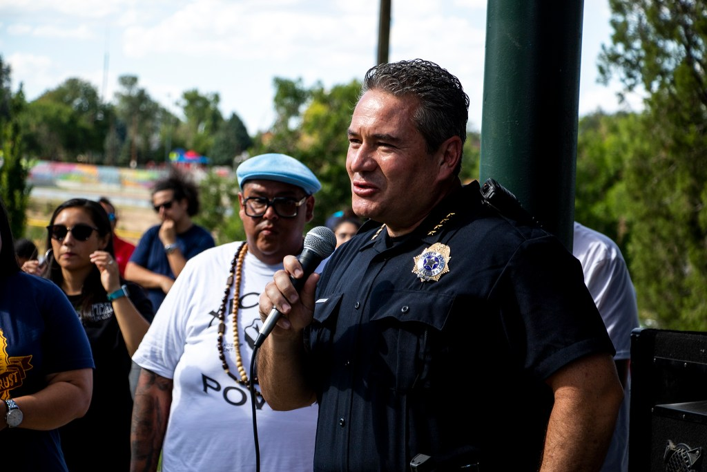 Denver Police Chief Paul Pazen speaks to a crowd at Barnum Park after a cruise down Federal Boulevard. Aug. 25, 2019. (Kevin J. Beaty/Denverite)