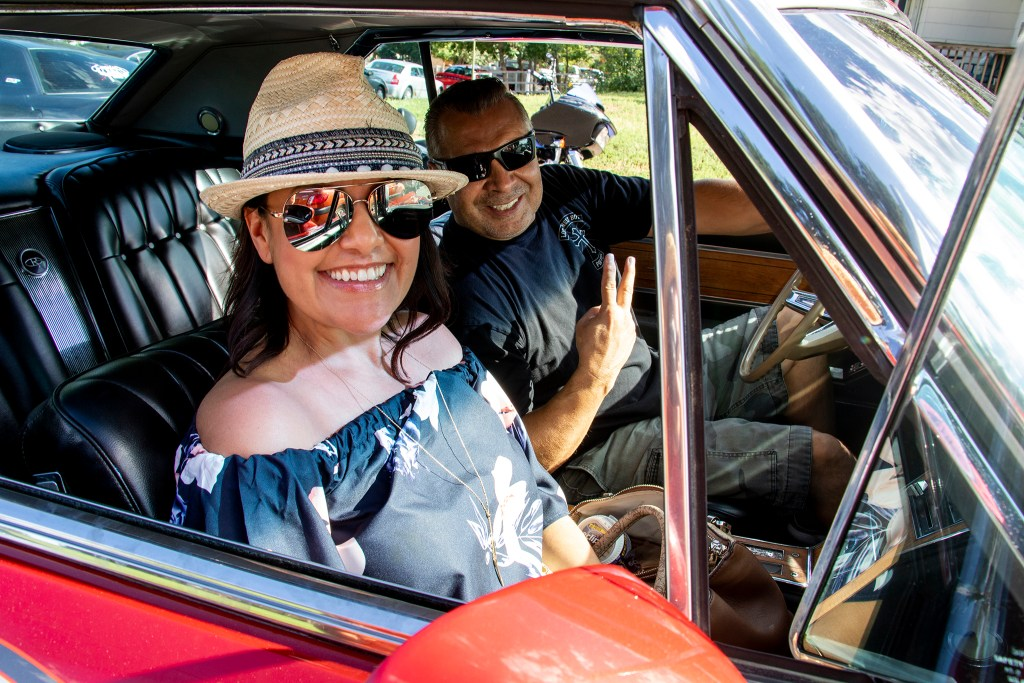 Jenine and Denver Police Commander Jeff Martinez cruise through Barnum Park. Aug. 25, 2019. (Kevin J. Beaty/Denverite)