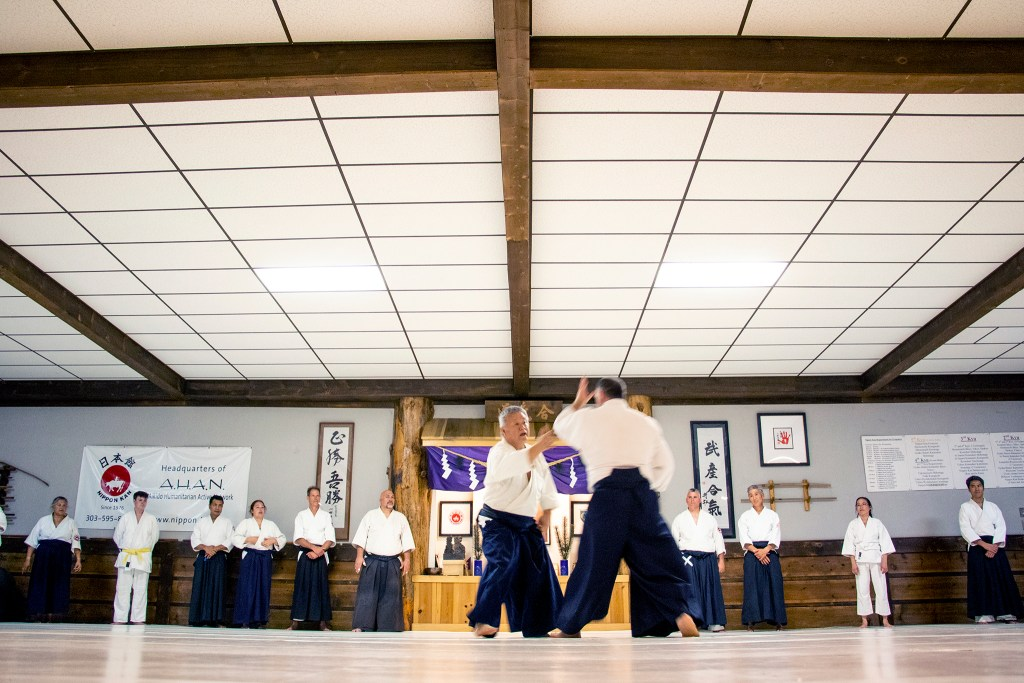 Sensei Gaku Homma teaches local students at Aikido Nippon Kan, his Lincoln Park dojo, Aug. 5, 2019. (Kevin J. Beaty/Denverite)