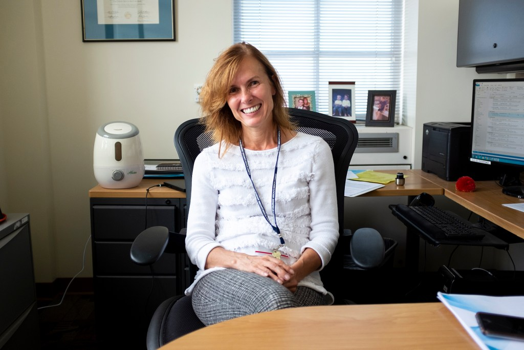 Cathy Bradley, an economist who leads the research program at the University of Colorado's cancer center in Aurora, poses for a portrait in her office. Aug. 16. 2019. (Kevin J. Beaty/Denverite)
