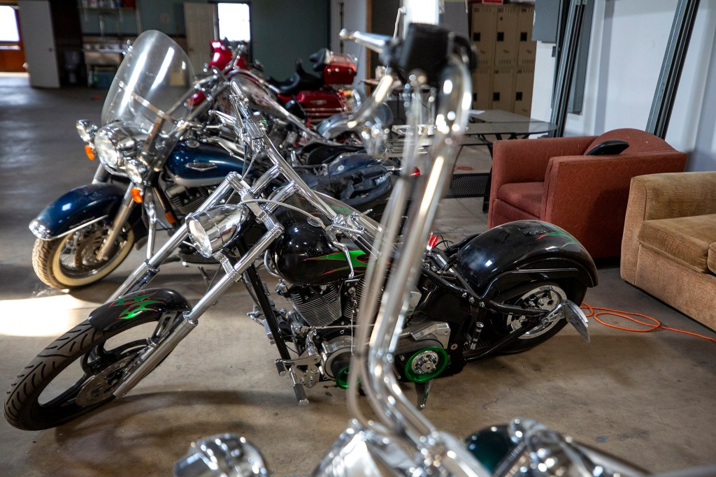 Bernard Hurley's motorcycle collection inside a warehouse on Chestnut Place a few blocks off of Brighton Boulevard. Sept. 24, 2019. (Kevin J. Beaty/Denverite)