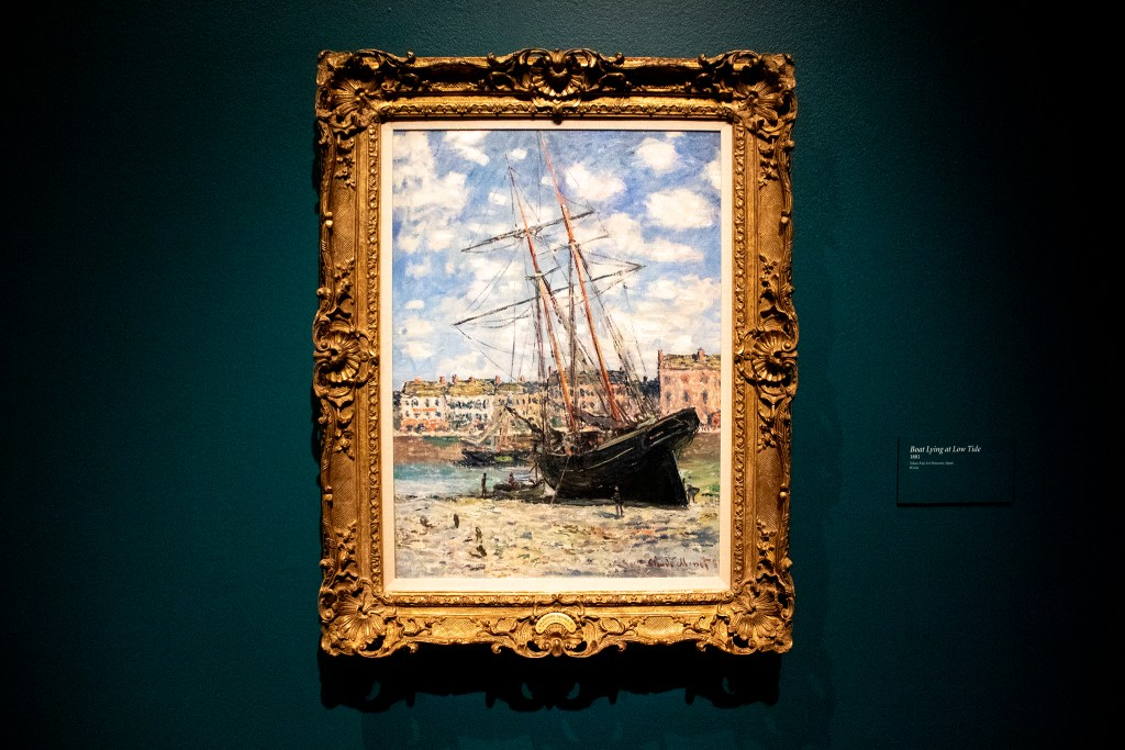 """Boat Lying at Low Tide"" on display in the Denver Art Museum's ""Claude Monet: The Truth of Nature"" exhibit Oct. 17, 2019. (Kevin J. Beaty/Denverite)"