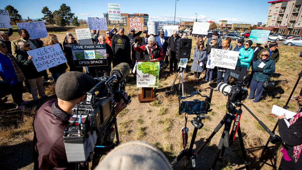 Woody Garnsey leads a rally on the edge of Park Hill Golf Course demanding the space not be redeveloped. Oct. 22, 2019. (Kevin J. Beaty/Denverite)