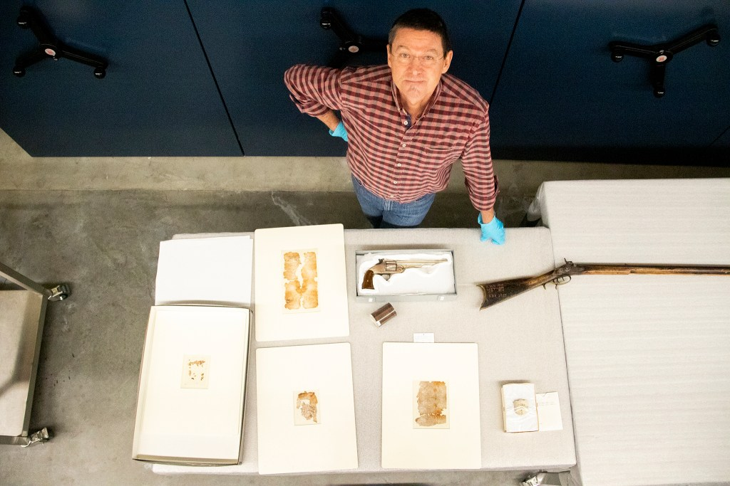 History Colorado curator James Peterson shows off some of his favorite items stored inside the museum's archive space downtown, Oct. 15, 2019. (Kevin J. Beaty/Denverite)